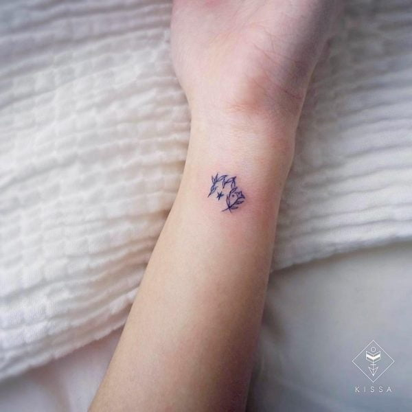 Mini Leaf Scorpio Symbol Wrist Tattoo