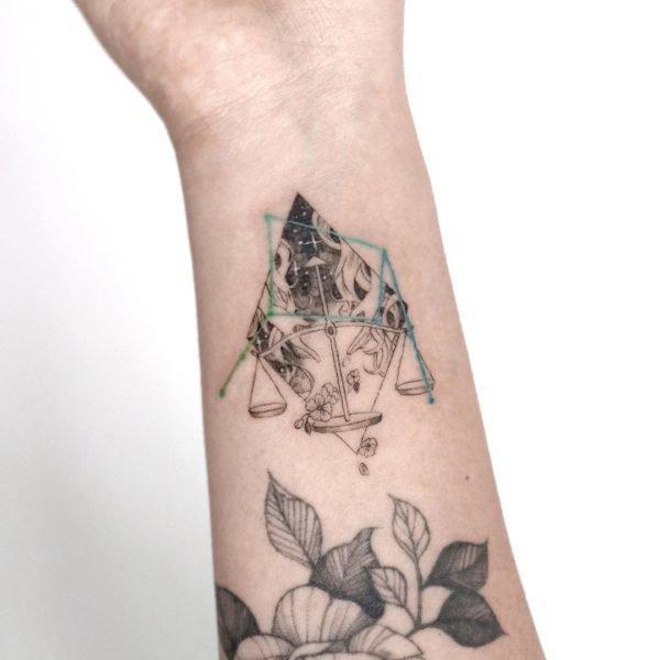Libra Illustrative Wrist Tattoo