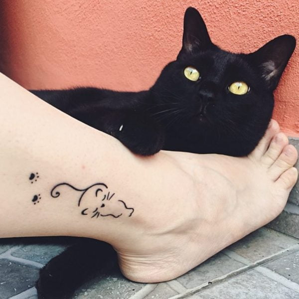 Abstract Black Cat Ankle Tattoo