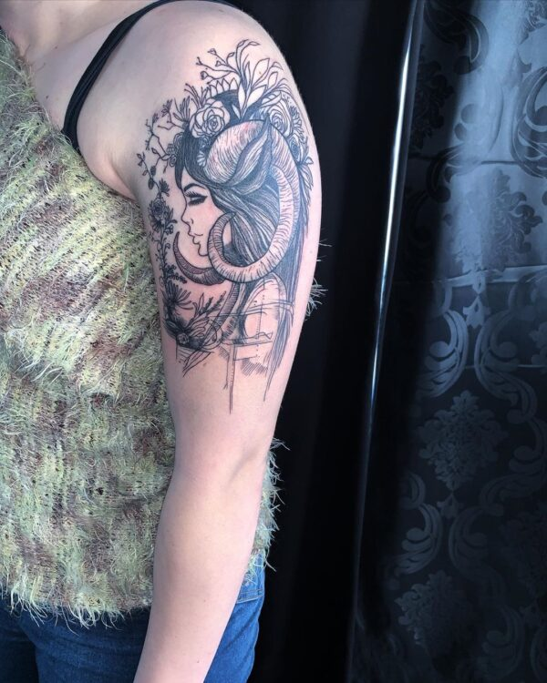Aries Girl with Horns Shoulder Tattoo