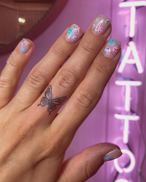 Butterfly Middle Finger Tattoo