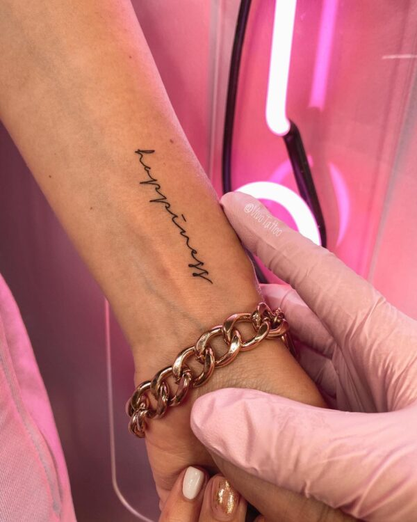 Happiness Script Wrist Tattoo