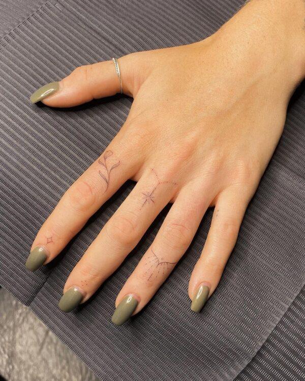 Star Chain And Vine Finger Tattoo
