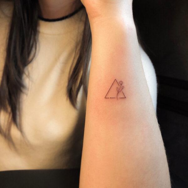 Triangle And Flower Wrist Tattoo