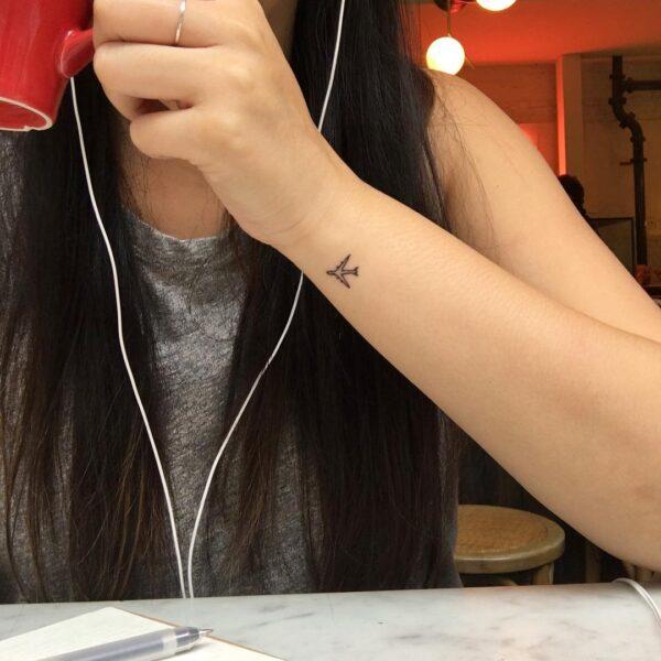 Mini Airplane Outline Wrist Tattoo