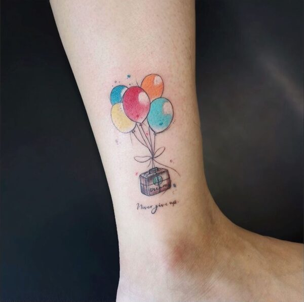 Balloon and Luggage Ankle Tattoo