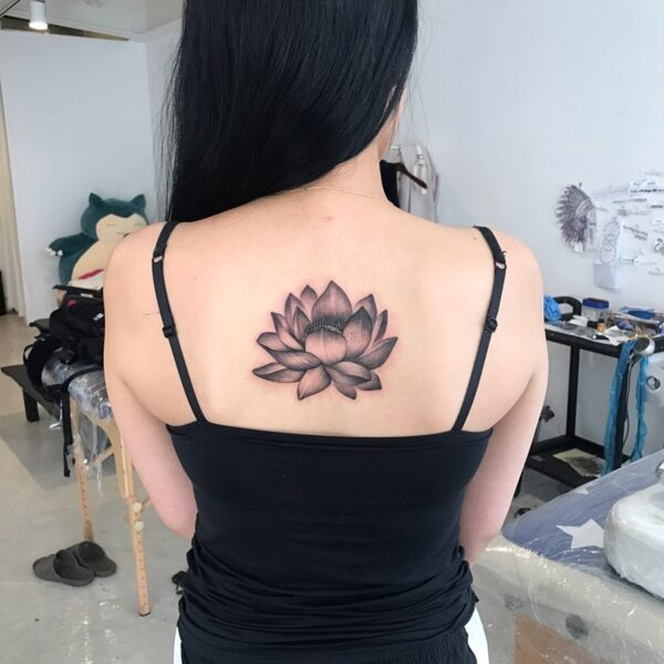 Illustrative Lotus Flower Back Tattoo