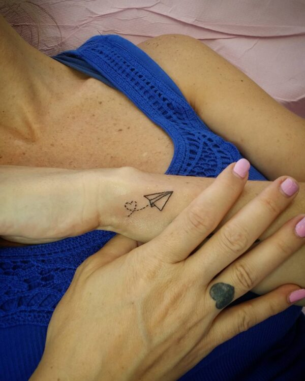 Paper Airplane Flying Wrist Tattoo