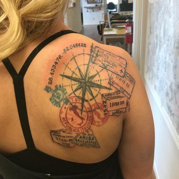 Passport and Compass Upper Back Tattoo